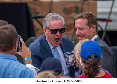 Mills River, North Carolina - 24 August 2020: The White House Chief of Staff, Mark Meadows, greets the attendees to the Farmers to Families Food Box feeding program
