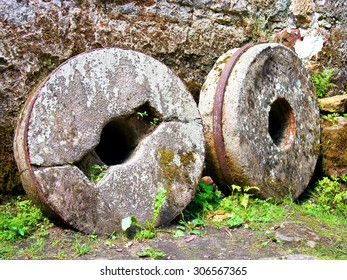 Millstone grinders round in old mill house
