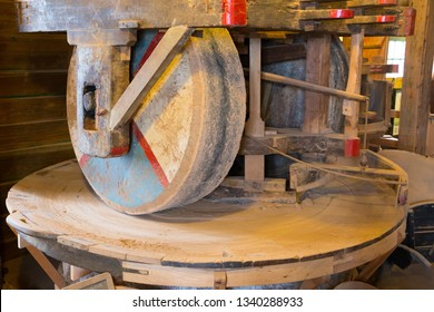 Millstone (mill stone) in a gristmill, wheel used for grinding wheat or other grains, in a historical windmill in Zaanse Schans, Netherlands..
