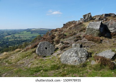 A millstone on Curbar Edge, a millstone grit outcrop high above the vilage of Curbar in The Debyshire Dales, England.