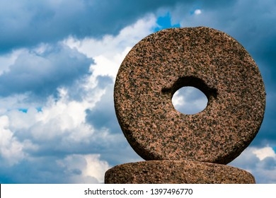 millstones against the background of the blue sky