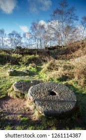 Millstones left abandoned at an old quarry in Hathersage, the stone was quarried here then carved into grindstones for the flour and paper trade,  Peak District, England, UK