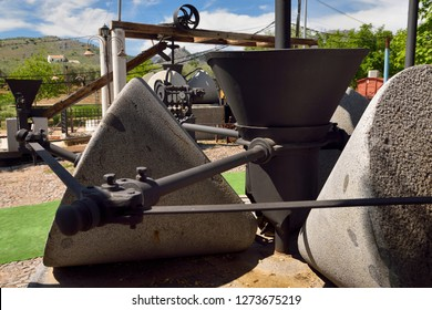 Millstones of Olive press machinery at Nicols Hostel Restaurant near Luque, Spain - May 1, 2015