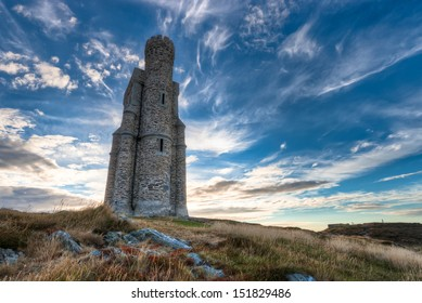 Milner's Tower on bradda Head near Port Erin in the Isle of Man, landscape format with blue sky and clouds