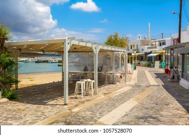 MILOS, GREECE - May 18, 2017: Coastal promenade in Pollonia village on Milos Island. Greece.