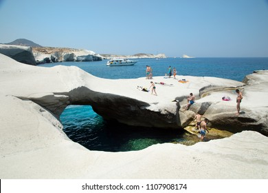 MILOS, GREECE-JUNE 6, 2017:  Sarakiniko  beach on Milos Island where waves driven by north winds shape the greyish-white volcanic rock into amazing shapes, and the area is often compared to moonscape