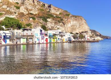 MILOS ISLAND - GREECE / 09.13.2017: Colourful houses beside the sea of the fishing village of Klima on Milos Island, Cyclades Island Group, Greece