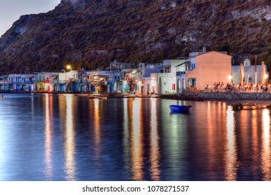MILOS ISLAND - GREECE / 09.13.2017: Colourful fishermen's boat houses at night, Klima village, Milos, Cyclades, Aegean Sea, Greek Islands