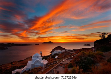 "MILOS ISLAND, GREECE. Sunset view from Kastro (literally ""castle""), next to Plaka village. The church in the foreground is named Panagia Thalassitra."