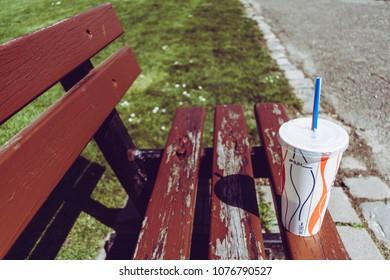 Milshake break on a bench