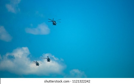 Miltary Helicopters soaring in the blue sky
