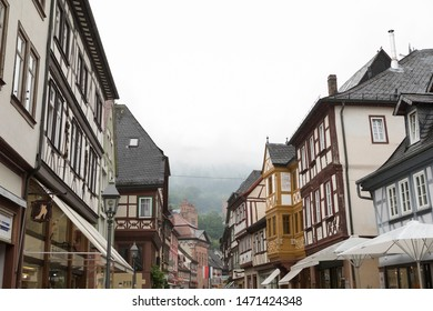 Miltenberg, Bavaria / Germany - July 11 2019: Clouds hanging over half-timbered houses at the picturesque town