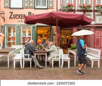 Miltenberg, Germany - 7/4/2013:  A mid mornig gathering of village men in Miltenberg, Bavaria, Germany