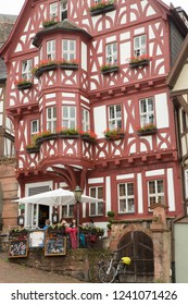 Miltenberg, Germany - 7/4/2013:  people having a mid morning coffee at a hotel cafe in Miltenberg, Bavaria, Germany