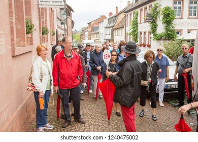 Miltenberg, Germany - 7/4/2013:  A tour group guidespeaking to his group in Miltenberg, Bavaria, Germany