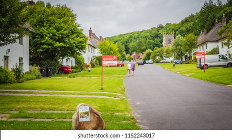 Milton Abbas , Dorset / UK - 07 11 2017: Old Medieval English village in the southwest of the UK. Street with old thatched houses in England.