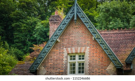 Milton Abbas, Dorset / UK - 07 11 2017: Details of a stone house in Milton Abbas. Old Medieval English village in the southwest of the UK. Street with old thatched houses in England.