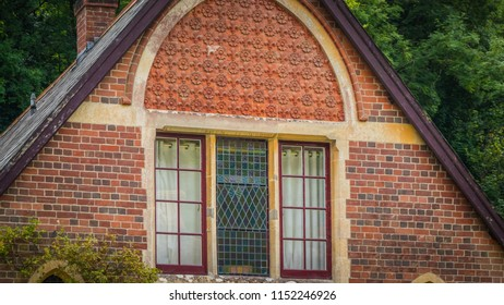 Milton Abbas, Dorset / UK - 07 11 2017: Details of a stone house with windows in Milton Abbas. Old Medieval English village in the southwest of the UK. Street with old thatched houses in England.