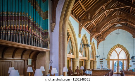 Milton Abbas, Dorset / UK - 07 11 2017: Milton Abbas medieval church interior with wooden structure Old Medieval English village in the southwest of the UK. Street with old thatched houses in England.