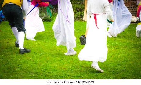 Milton Abbas / UK - July 29 2017: Children are dancing traditional dance during the 18th century street in Milton Abbas village, Dorset, UK. Traditional English medieval street fair in the countryside