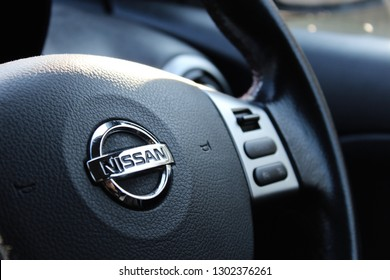 Milton Keynes, Buckinghamshire / UK - February 2, 2019: Close up of Nissan steering wheel.