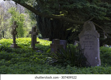 MILTON KEYNES, ENGLAND - APRIL 22, 2015: View at Holy Trinity Church churchyard with ancient graves and tombs in Old Wolverton, UK.