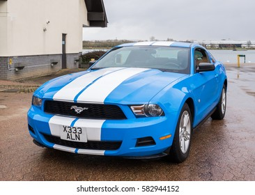 MILTON KEYNES, UK - 14 FEBRUARY 2017: Ford Mustang tuning sport-car colored in blue color with white stripes. Editorial photo