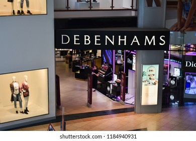 Milton Keynes, UK - 20 August 2018: An outside view of the department store Debenhams in a shopping center mall.