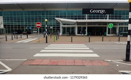 Milton Keynes, UK - 23 August 2018: An outside view of an Asda George by walmart from the car park in front of a zebra crossing cross walk.