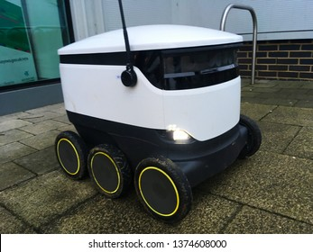 Milton Keynes, UK - 26 December 2018: A starship modern autonomous automatic robot drone delivery bot robotic vehicle on wheels used to take groceries online store shopping orders to your home door.