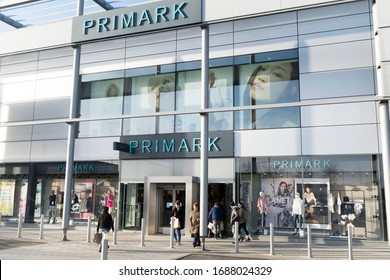 MILTON KEYNES, UK - February 12, 2020. Exterior of a large Primark store and shoppers at MK1 retail park in Milton Keynes