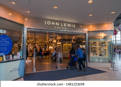 Milton Keynes,England-August ,2019:Entrance into the John Lewis Partnership store. It is a British company which operates John Lewis department stores and Waitrose supermarkets