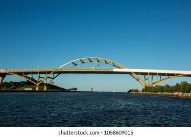 Milwaukee Hoan bridge at sunset, with third ward pier light