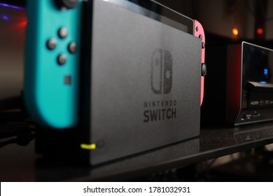 Milwaukee, WI / USA - July 20, 2020: A Nintendo Switch stands in its charger below a TV. People use Animal Crossing and online gaming to communicate during COVID-19 while social distancing.