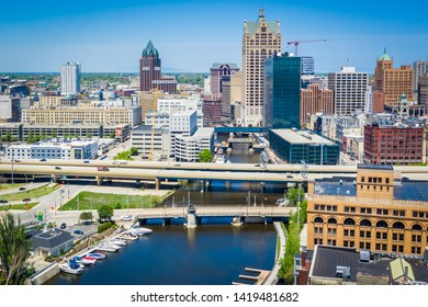 Milwaukee, WI / USA - June 07, 2019:  Aerial view of Milwaukee, Wisconsin looking north towards the downtown area. Featuring the Milwaukee river in the foreground, Third Ward to the viewers right.