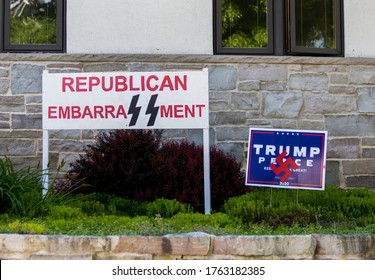 Milwaukee, Wisconsin - 06/24/20: Anti Trump Signs Posted in a Yard. The signs give reference to the Nazis through both the Swastika and the SS Logo of the Schutzstaffel