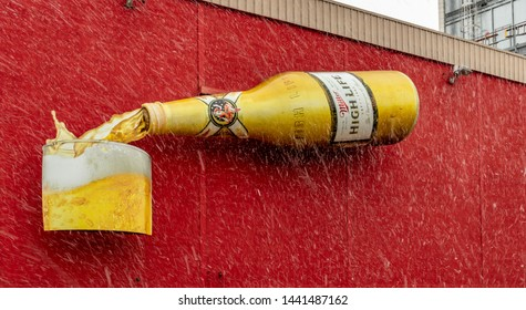 Milwaukee, Wisconsin - April 10th, 2019 - Giant Miller High Life bottle being poured outside Miller Brewery, Milwaukee, on a snowy spring day.