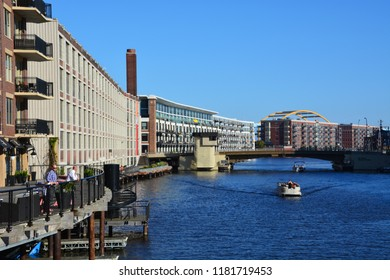 Milwaukee, Wisconsin / United States - Sept. 15, 2018: Looking down Milwaukee's River Walk past warehouses converted to condos in the historic Third Ward.