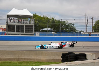 Milwaukee Wisconsin, USA - August 17, 2014: Indycar Indy Lights series race, Milwaukee Mile. Matthew Brabham ahead of Zach Veach side by side racing.