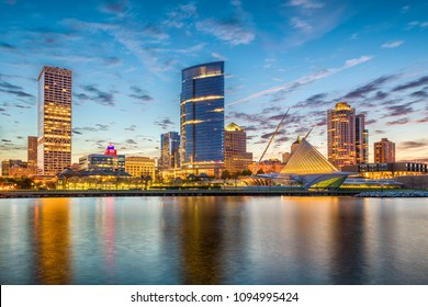 Milwaukee, Wisconsin, USA downtown city skyline on Lake Michigan at twilight.