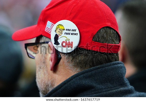 """Milwaukee, Wisconsin / USA - January 14th, 2020: Anti-CNN """"You Are Fake News"""", pin pinned to a 45th President Donald Trump supporter's hat at UW-Milwaukee Panther Arena Make America Great Again."""