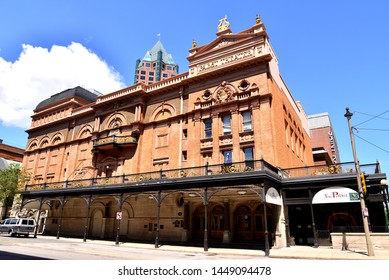 Milwaukee, Wisconsin / USA - July 11, 2019:  The beautiful architecture of the Pabst Theater downtown Milwaukee on a bright summer day with deep blue sky and a few clouds in the distance.