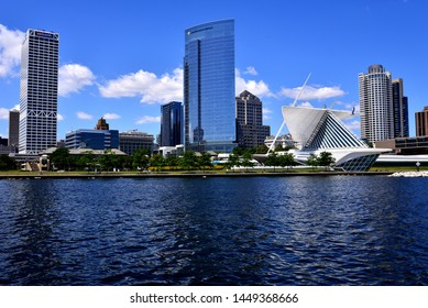 Milwaukee, Wisconsin / USA - July 11, 2019:  The beautiful skyline of Milwaukee reflecting in the clam harbor waters along the shores of Lake Michigan on a wonderful summer day.