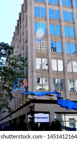 Milwaukee, Wisconsin / USA - July 11, 2019: The Foxconn Building in downtown Milwaukee with construction equipment along the street.