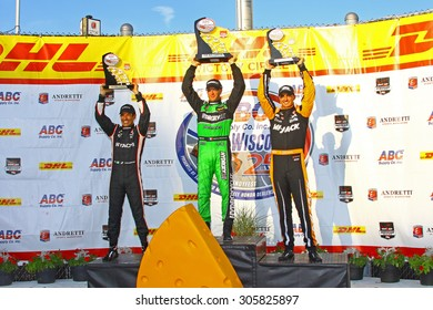 Milwaukee Wisconsin, USA - July 12, 2015: Verizon Indycar Series Indyfest ABC 250 at the Milwaukee Mile. Victory Circle Podium - Helio Castroneves, Sebastien Bourdais, Graham Rahal