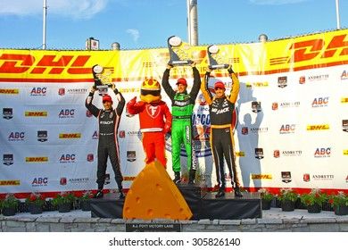 Milwaukee Wisconsin, USA - July 12, 2015: Verizon Indycar Series Indyfest ABC 250 at the Milwaukee Mile. Victory Circle Podium - Helio Castroneves, Sebastien Bourdais, Graham Rahal, Firestone Firehawk
