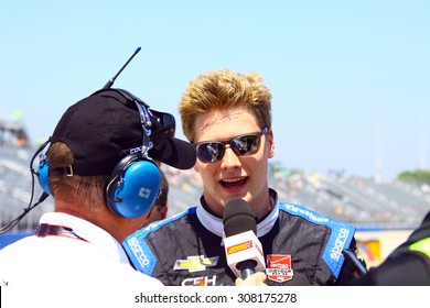 Milwaukee Wisconsin, USA - July 12, 2015: Verizon Indycar Series Indyfest ABC 250 at the Milwaukee Mile.  Rob Howden Motorsports Journalist interviews Joseph Newgarden.