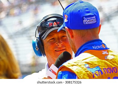 Milwaukee Wisconsin, USA - July 12, 2015: Verizon Indycar Series Indyfest ABC 250 at the Milwaukee Mile.  Rob Howden Motorsports Journalist interviews driver Charlie Kimball