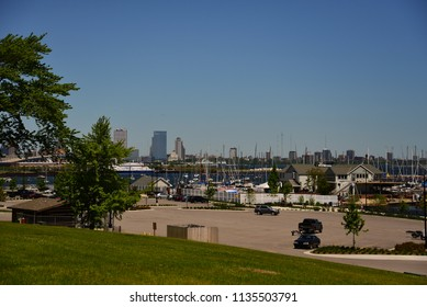 Milwaukee, Wisconsin / USA - June 13, 2018: The Milwaukee skyline in the distance beyond a Lake Michigan harbor.
