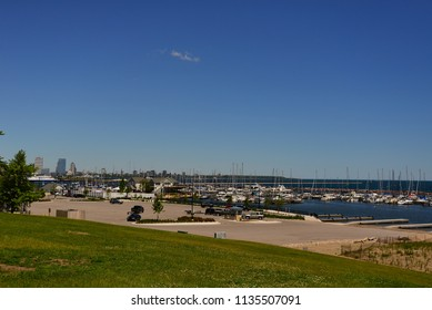 Milwaukee, Wisconsin / USA - June 13, 2018: The Milwaukee skyline beyond a southside harbor on Lake Michigan.
